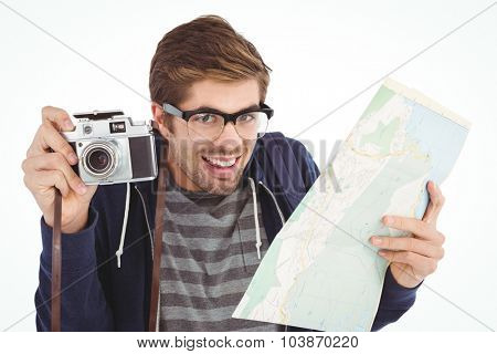 Portrait of happy man holding map and camera against white background