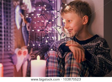 Boy Waiting Santa On The Window With Christmas Lights