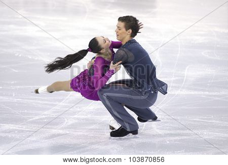 BARCELONA - DEC, 11: Alla Loboda and Pavel Drozd from Russia during Junior Pairs Ice Dance event of ISU Grand Prix of Figure Skating Final 2014 at CCIB on December 11, 2014 in Barcelona, Spain