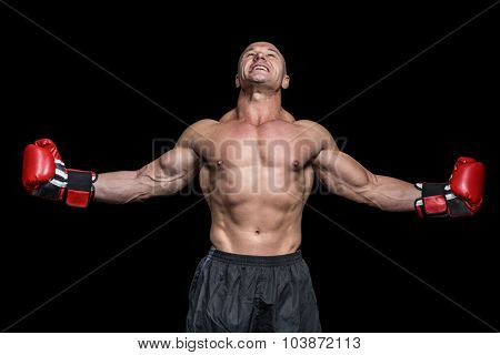 Boxer with arms outstretched against black background
