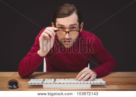Portrait of surprised creative businessman working at desk in office