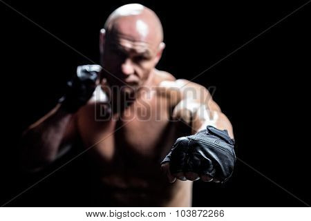 Fighter with black gloves against black background