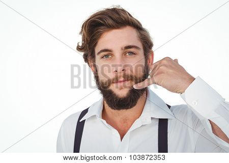 Portrait of confident hipster gesturing against white background