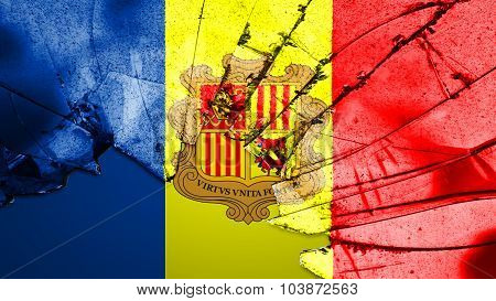 Flag of Andorra painted on broken glass texture.
