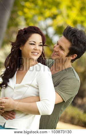 Young attractive couple in love at a park