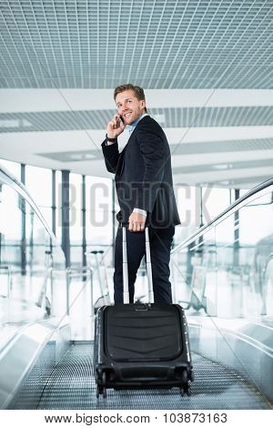 Businessman with suitcase at the airport