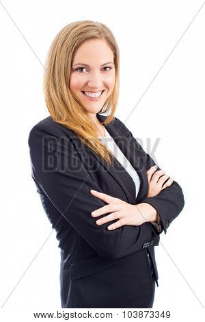 Attractive young woman in business suit with arms crossed