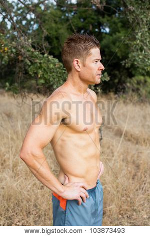 Fit athletic man standing outside in nature