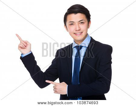 Asian Young Businessman showing finger point up