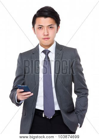 Asian Businessman hold with mobile phone