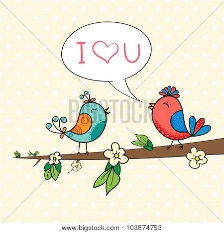 Cute bird couple on blossom branch.