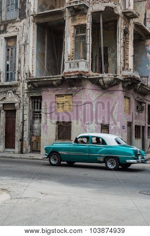 Cuban Street Scene With People And Classic Car