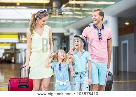 Family with child in the airport