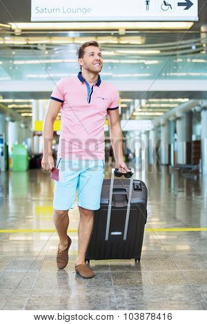 Man with a suitcase at the airport