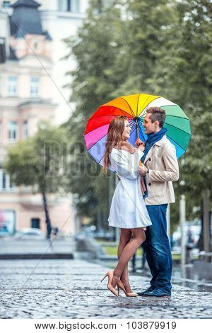 Young couple with an umbrella