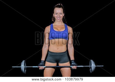 Portrait of cheerful woman lifting black background