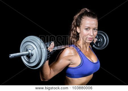 Portrait of fit woman lifting black background
