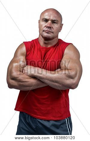 Portrait of confident bodybuilder against white background