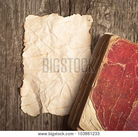 Old Paper And Book On The Wood Background