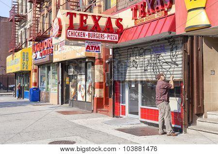 Man Opening Shop In Harlem District.