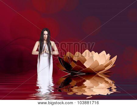 Woman in white dress beside lotus