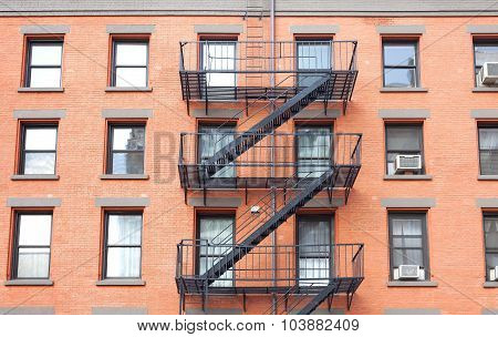 Fire Escape Ladders, Brick Building In New York, Usa.
