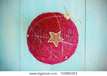 Christmas  Red Ball Over Wooden Background