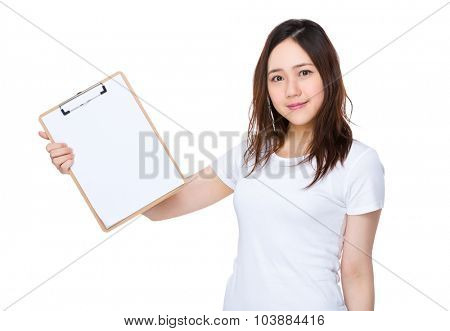 Young woman show with blank page of clipboard
