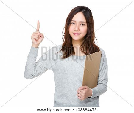 Young woman hold with clipboard and finger up
