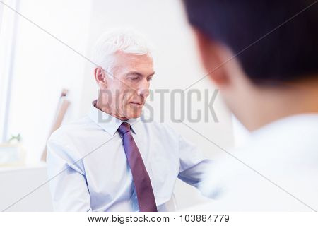 Businessman working in office at the desk