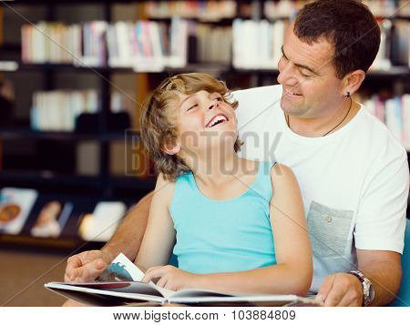 Father with son in library with books
