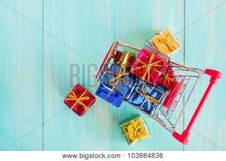Cart With Gifts On Wooden Background