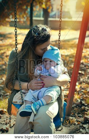 Mother and cute baby boy outside the park