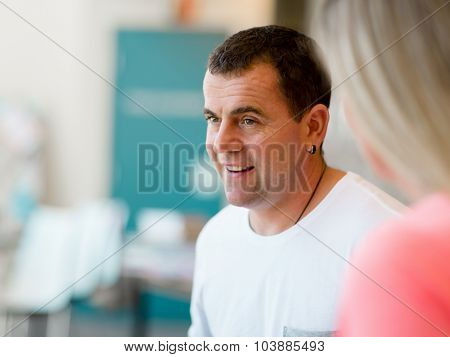 Portrait of smiling man indoors in casual clothes