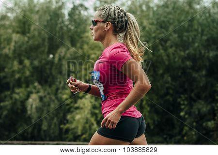 participant of marathon running on track