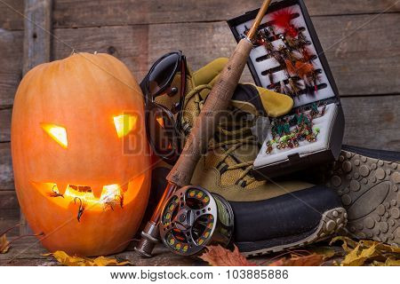 Halloween Pumpkin With Wading Boots And Fly-fishing