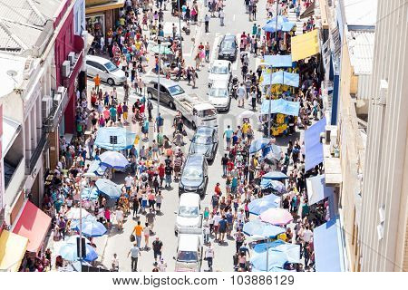 SAO PAULO, BRAZIL - CIRCA DEZ 2014: Hundreds of People walk along the 25 March area in Sao Paulo, Brazil. 25 March is a popular commerce region near the center of Sao Paulo, Brazil.