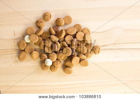 Heap Of Dutch Sweet Kruidnoten On A Wooden Plate