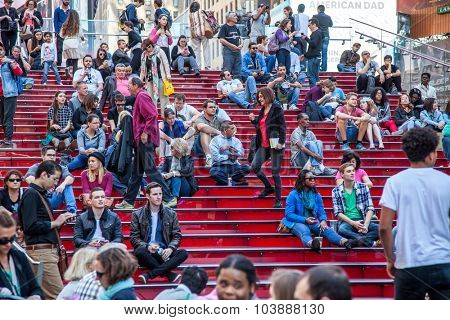 NEW YORK CITY, USA - SEPTEMBER, 2014: People resting on famous red stairs on Times Square New York City