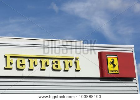 Ferrari logo on a facade of a dealer