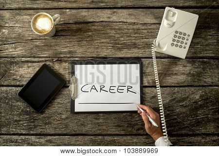Overhead View Of Career Adviser Writing Word Career On A White Sheet Of Paper