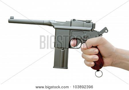 The Handgun Mauser M-72 In His Hand. Air Gun