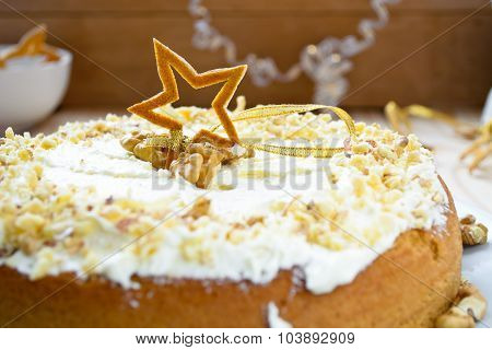 Homemade cake with butter cream and walnuts