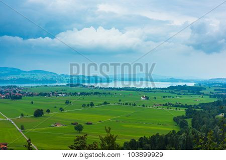 Green Fields And A Lake