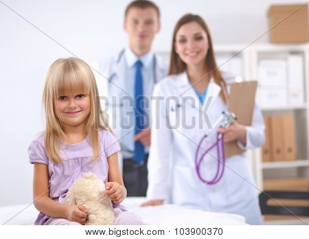 Female doctor examining child with stethoscope at surgery