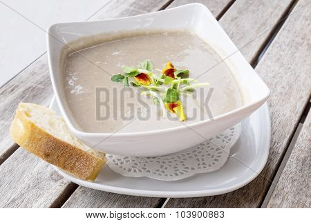 Cream of Mushroom Soup Served with a Slice of French Baguette