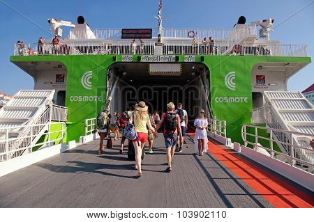 Tourists Board On The Ferry To Santorini Island At The Port Of Heraklion, Crete, Greece.