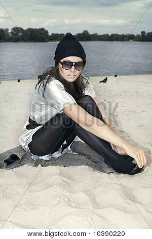 Portrait Of A Beautiful Woman In Sunglasses On The Beach