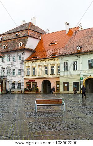 Houses with famous eye-shaped windows at main square in Sibiu, Transylvania, Romania