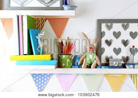 Shelves with toys in child room close-up
